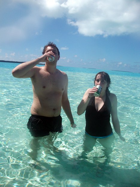 The boyf and I in the Aitutaki lagoon drinking Heineken. It tasted amazing.