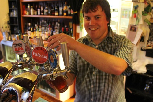 Richard Deeble pouring his Deeble's Pale Ale at the Kelburn Village Pub.